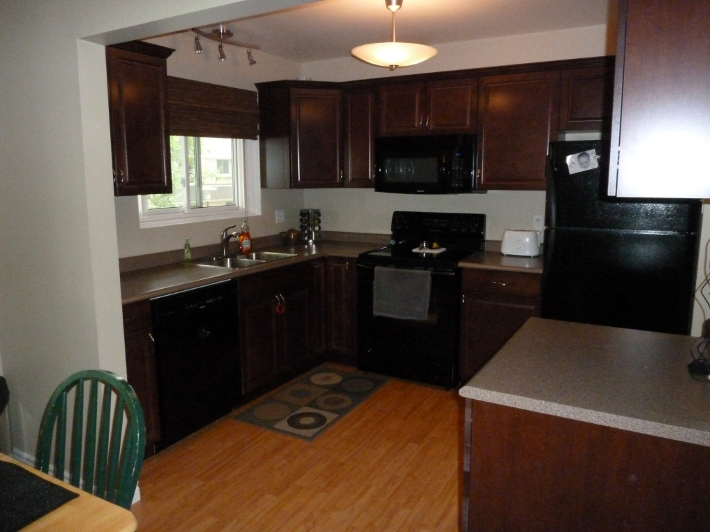 black appliances with cherry cabinets kitchen cabinets blind corner
